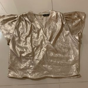 Shimery silk blouse golden color